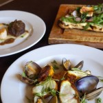 Spiced monkfish with puff pastry biscuit, clams & sweet potato; Coriander flatbread with hummus, rocket, roast fig, pomegranate & gremolata; and Braised pigs cheeks with seared scallops, fennel & apple puree